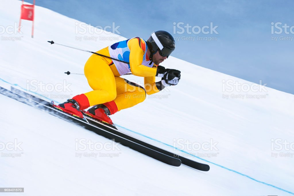 Side View of Young Male Skier at Downhill Ski Training stock photo