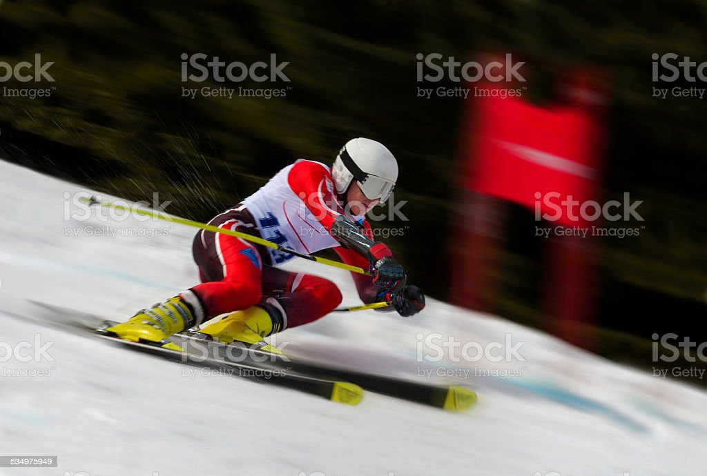 Side View of Young Man at Giant Slalom Competition stock photo