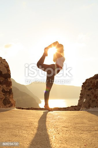 istock Side view of young woman standing on edge at rocks 505234732