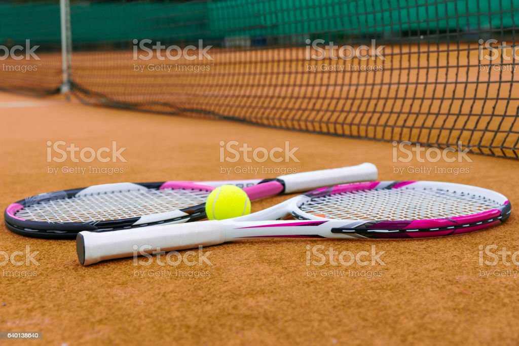 Side view on tennis rackets with a tennis ball stock photo