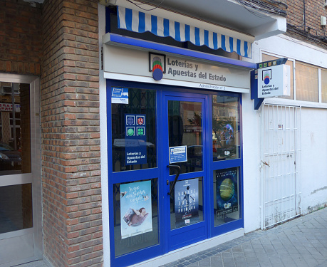 side view on the facade of an spanish official national lottery outlet