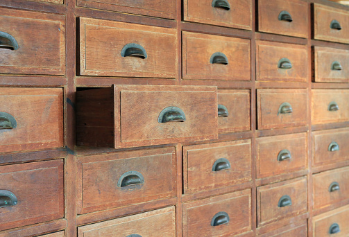 668340340 istock photo Side view Open old wooden drawer. 940914198