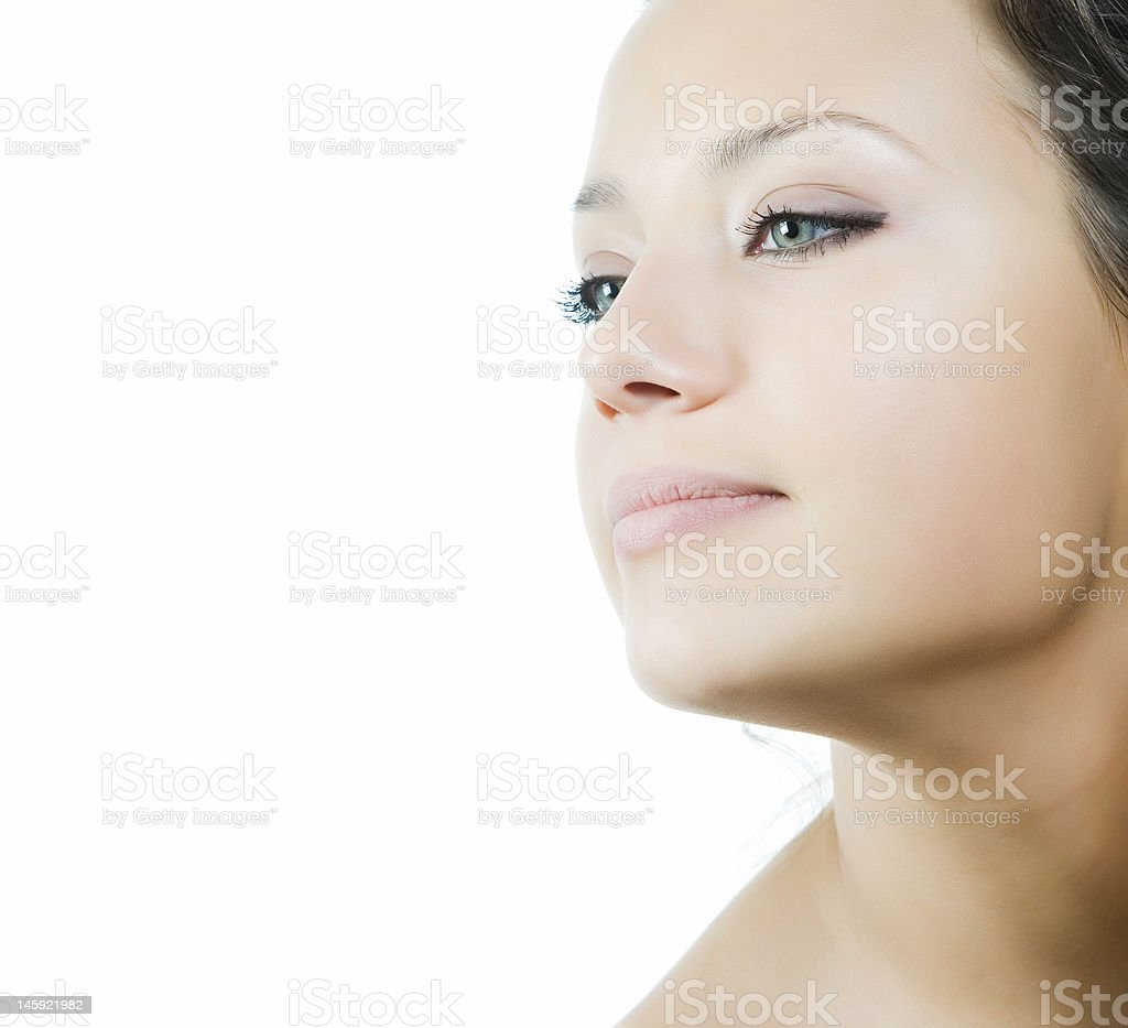 Side view portrait of a pretty woman in a studio royalty-free stock photo