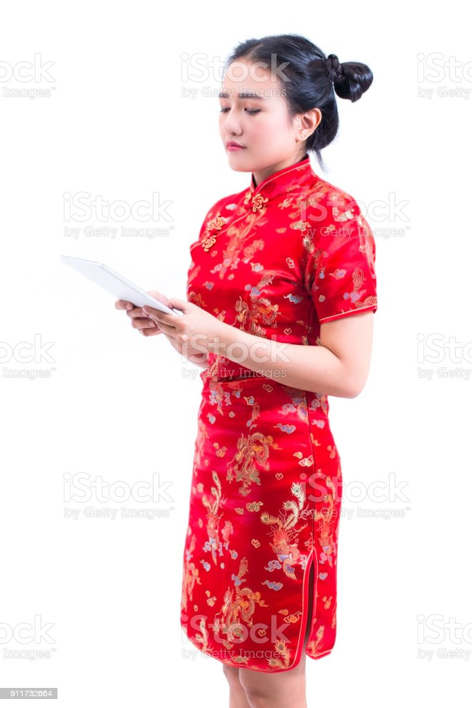 c93fbd798 Side view portrait of Beautiful Young asian woman wear chinese dress  traditional cheongsam or qipao using