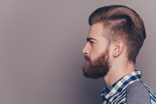 636829368 istock photo Side view portrait of handsome stylish young man with beard 636829520
