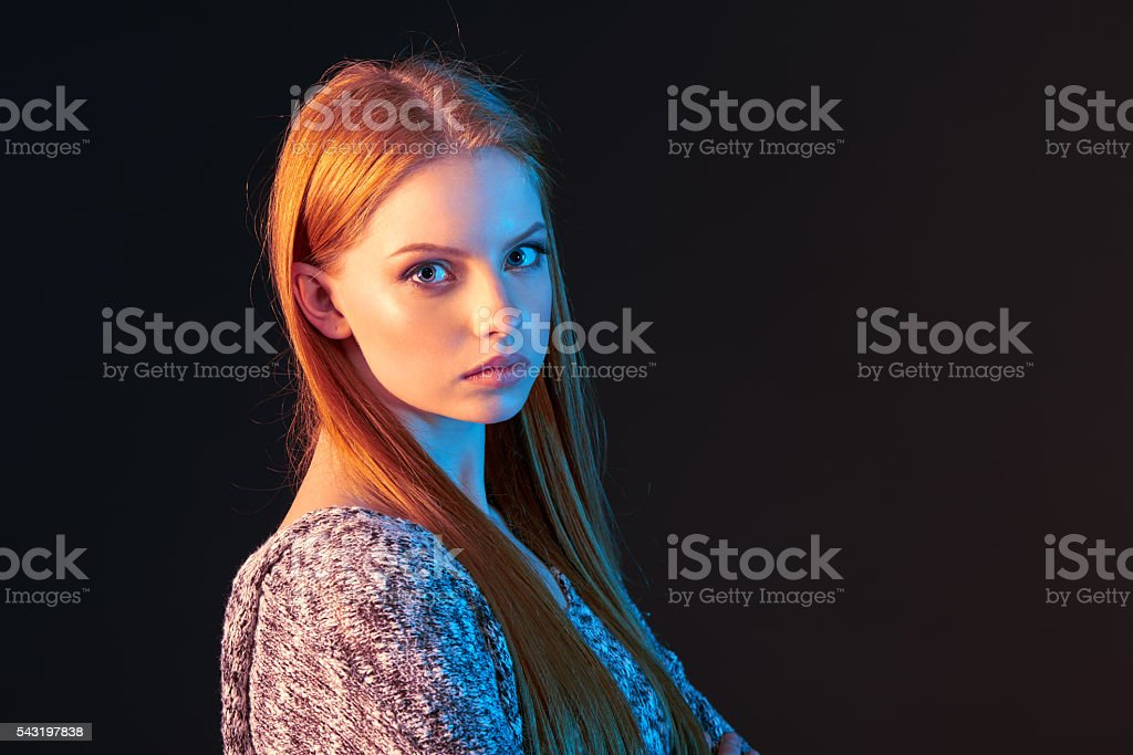 Side view portrait of red haired girl looking forward - Photo