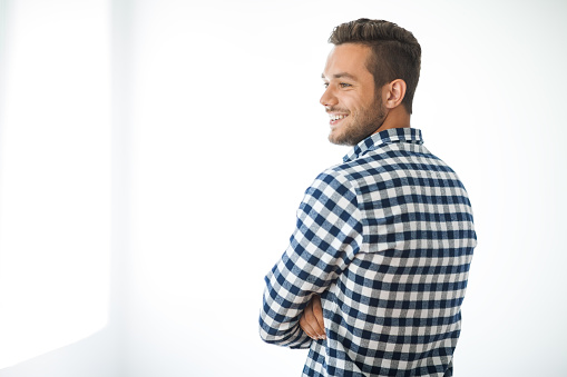 834639402 istock photo Side view portrait of smiling handsome man on white background 834639402