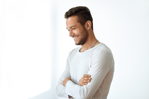 834639402 istock photo Side view portrait of smiling handsome man on white background 834639460