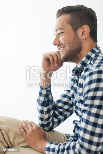 834639402istockphoto Side view portrait of smiling handsome man 834639412