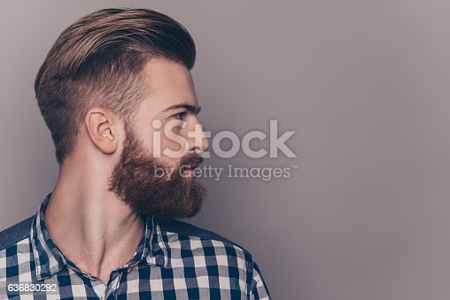 istock Side view portrait of thinking stylish young man looking away 636830292