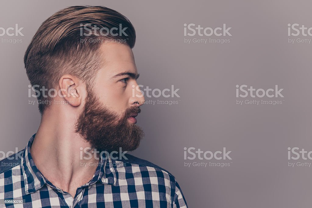 Side view portrait of thinking stylish young man looking away stock photo