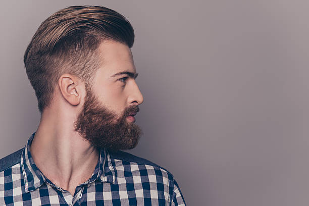 side view portrait of thinking stylish young man looking away - beard stock pictures, royalty-free photos & images