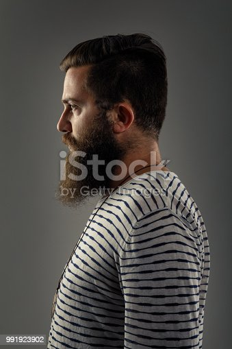 636829368istockphoto Side view portrait of thinking stylish young man looking away. 991923902
