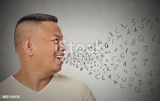 istock Side view portrait young handsome man talking with alphabet letters coming out of open mouth 663149426