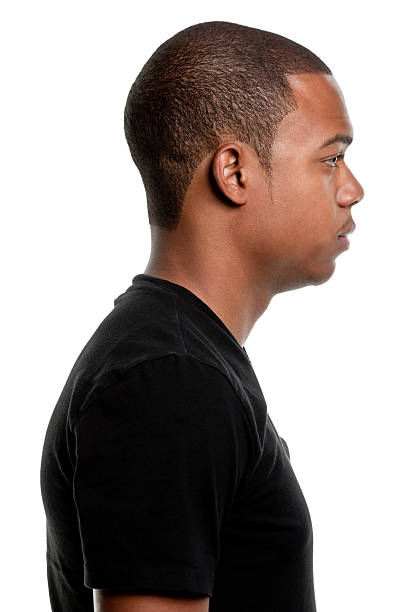 Side View Profile Portrait of Serious Young Man stock photo