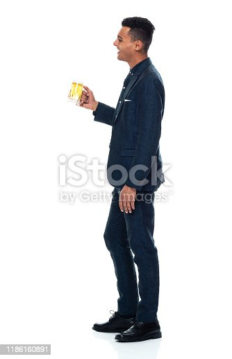 istock Side view / profile view / full length / one man only / one person of 20-29 years old adult handsome people black hair / short hair african ethnicity / african-american ethnicity male / young men businessman / business person standing wearing a suit 1186160891