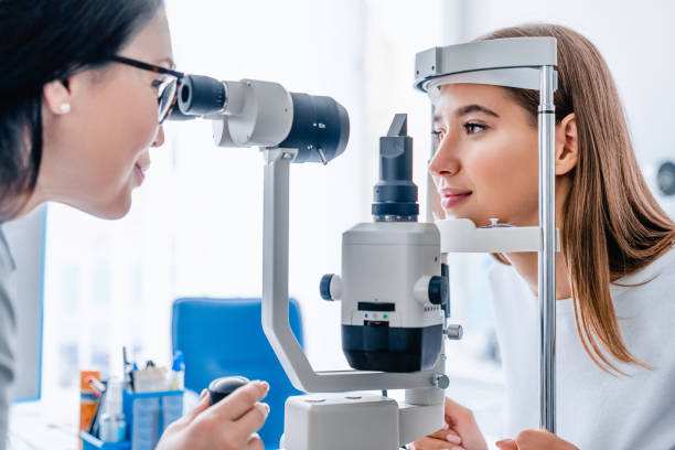 Side view shot of female doctor and patient in ophthalmology clinic Medicine, Hospital, Medical Clinic, Ophtalmologist, Exam optical instrument stock pictures, royalty-free photos & images