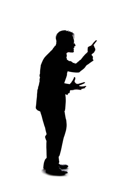 Side View Silhouette of a Businessman Shouting in Anger stock photo