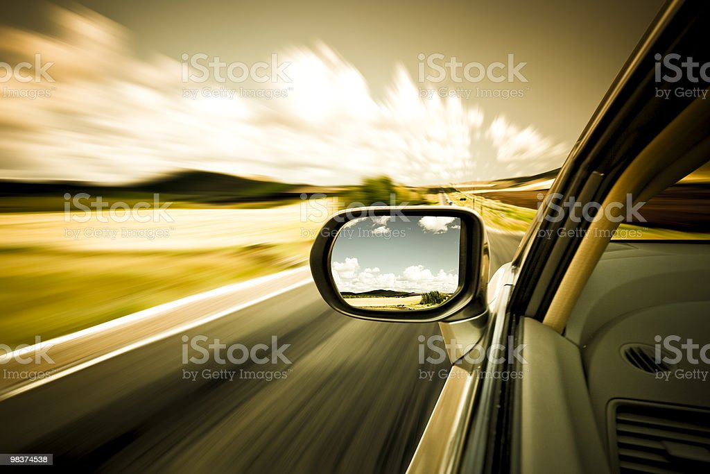 Side view still shot of car mirror as view zooms by royalty-free stock photo