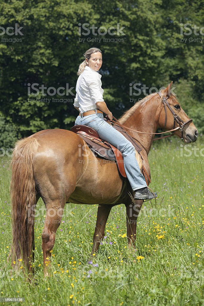 side view woman sitting on horse stock photo