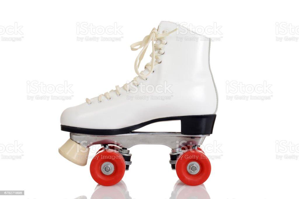side view women white quad roller skate stock photo