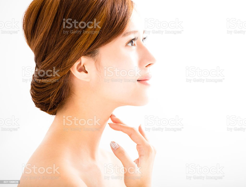 side view young smiling  woman with clean face stock photo