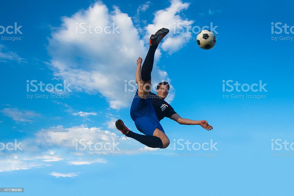 Side volley kick against the blue sky royalty-free stock photo