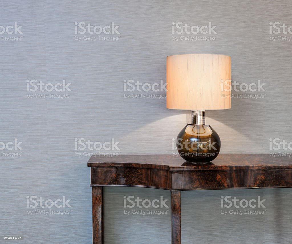 Sideboard with table lamp stock photo