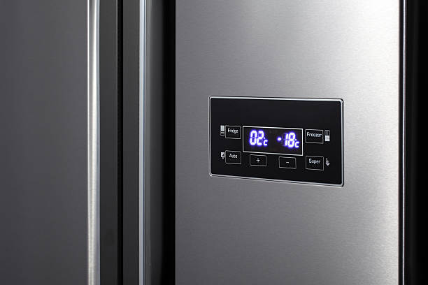 Side-by-side refrigerator. stock photo
