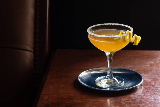 Sidecar Cocktail Served Up with Sugared Rim in Dark Luxurious Bar stock photo