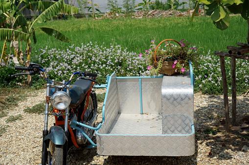 Thai local sidecar motorbike at urban green filed farm