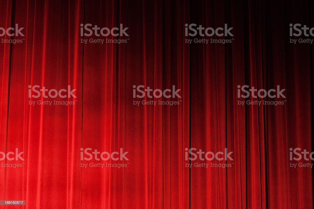 Sidelit closed ruched red velvet theatre drapes stock photo