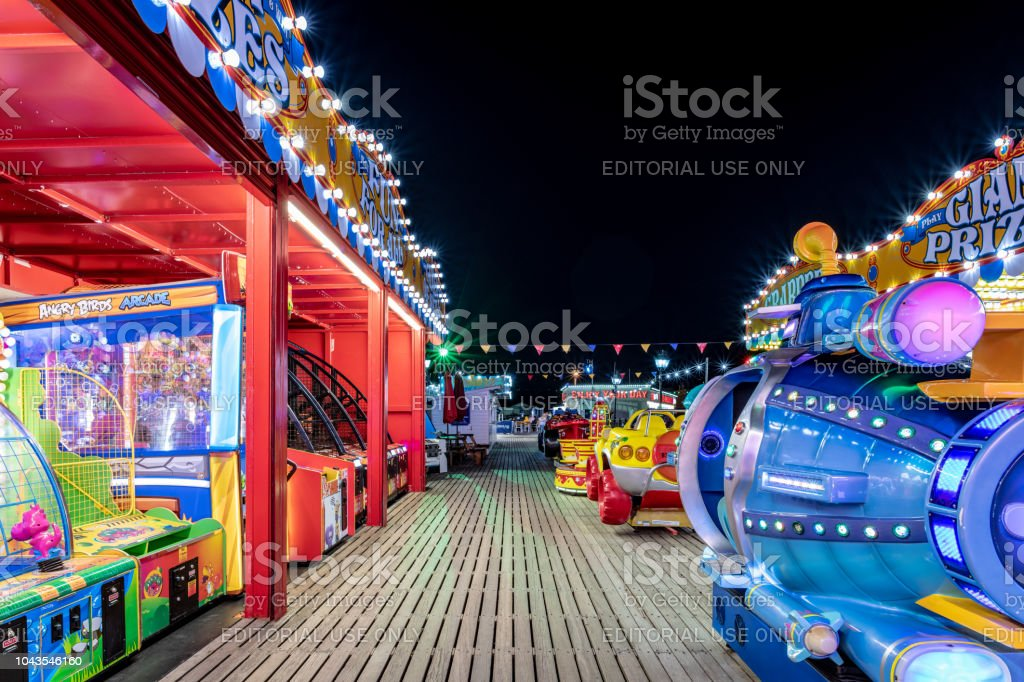 Sideshows and children's rides on Paignton Pier stock photo