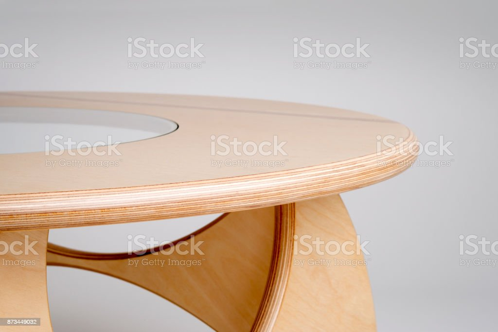 Sideview Close Up of Bare Wood Designer Round Table stock photo