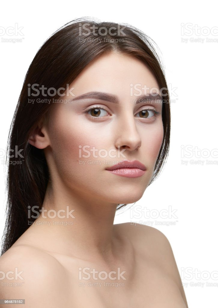 Sideview of a girl with light day make up looking at camera. royalty-free stock photo