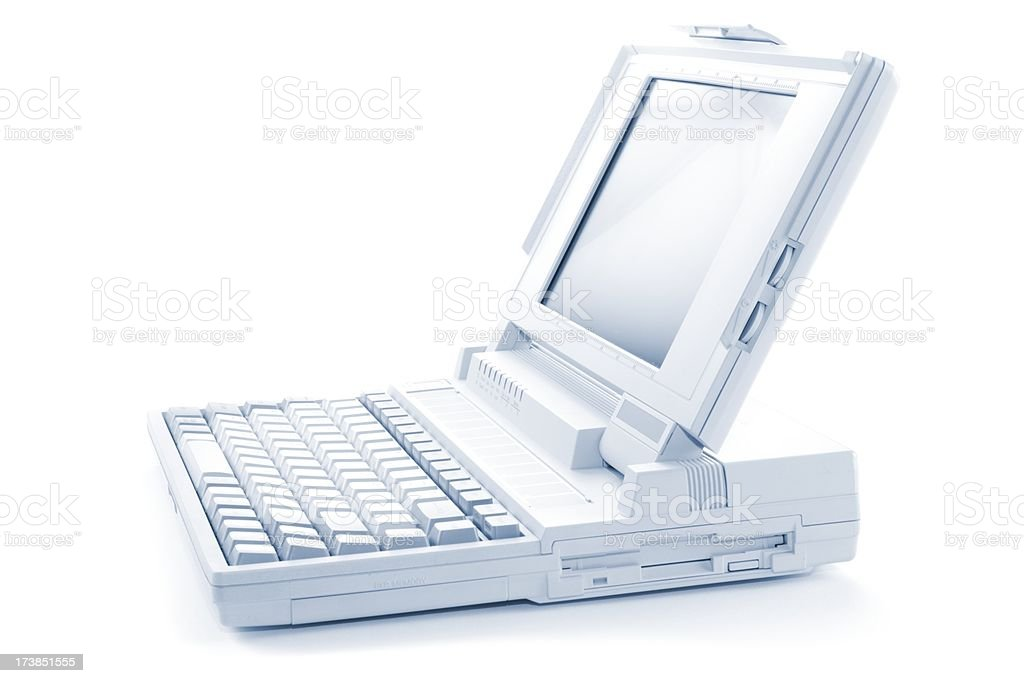 Sideview of an old white Laptop Notebook isolated royalty-free stock photo