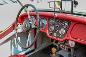 Athens, Georgia - July 01, 2017: Sideview of the cockpit of a vintage Triumph Roadster TR3 on display at the monthly gathering of classic car enthusiasts called Cars & Coffee.