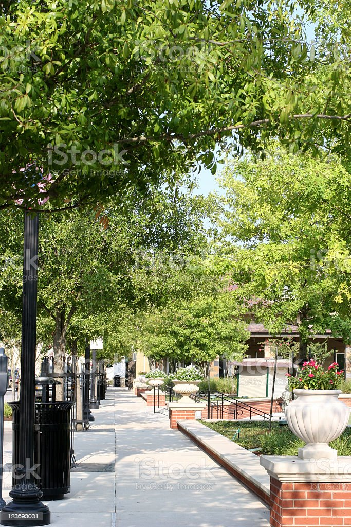 Sidewalk alongside a plaza in shopping center royalty-free stock photo