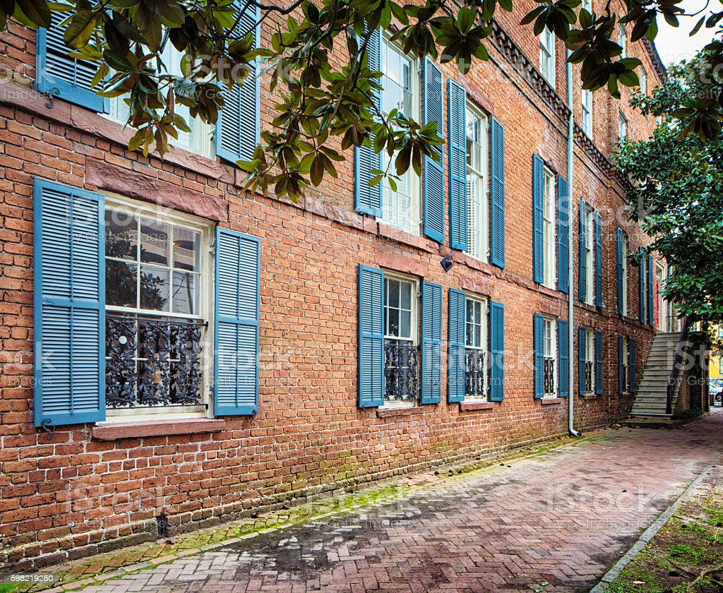 Sidewalk and colonial brick building side view stock photo