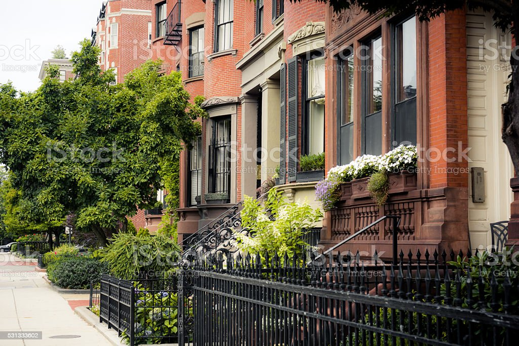 Sidewalk and houses in Beacon Hill neighborhood of Boston, MA stock photo