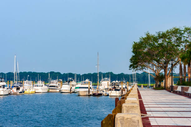 Sidewalk at a Lakefront park next to a fully occupied marina near Beaufort, SC