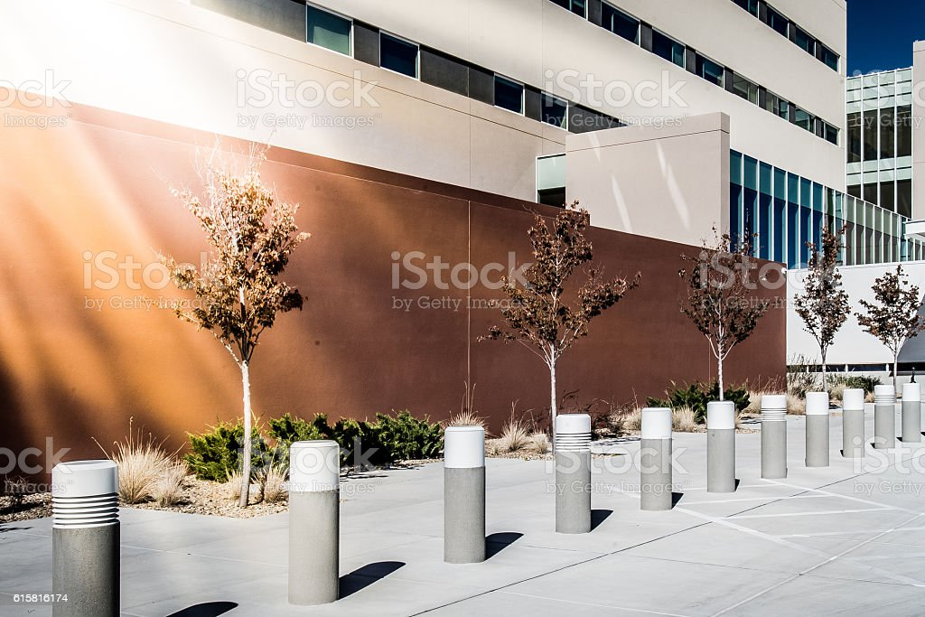 Sidewalk by Modern Building with Bollards stock photo