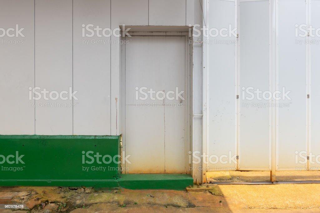 sidewalk by street wall & door stock photo