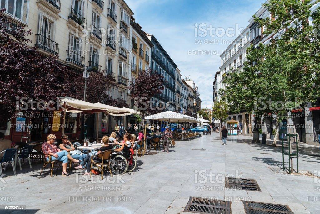 Sidewalk cafes in Square of Angel in MaAdrid stock photo