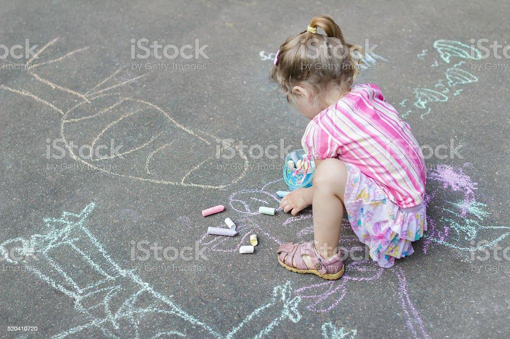 Sidewalk Chalk Drawings Of Little Caucasian Girl Wearing Ruffle