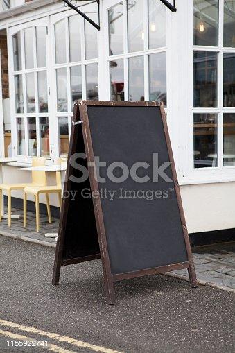 628470570 istock photo Sidewalk chalkboard street sign 1155922741