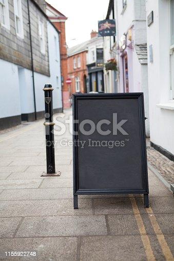 628470570 istock photo Sidewalk chalkboard street sign 1155922748