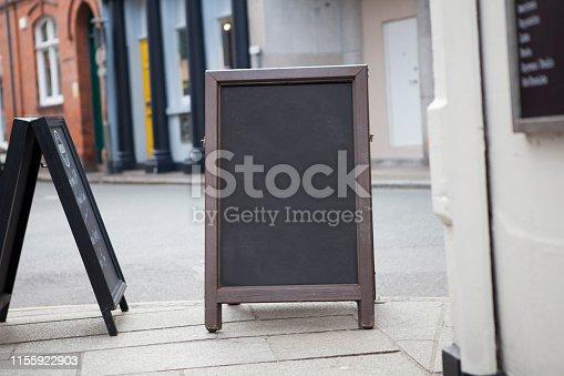 628470570 istock photo Sidewalk chalkboard street sign 1155922903