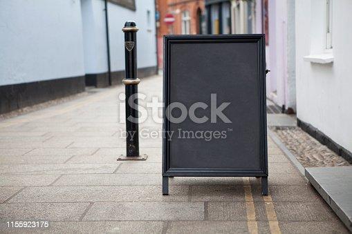 628470570 istock photo Sidewalk chalkboard street sign 1155923175