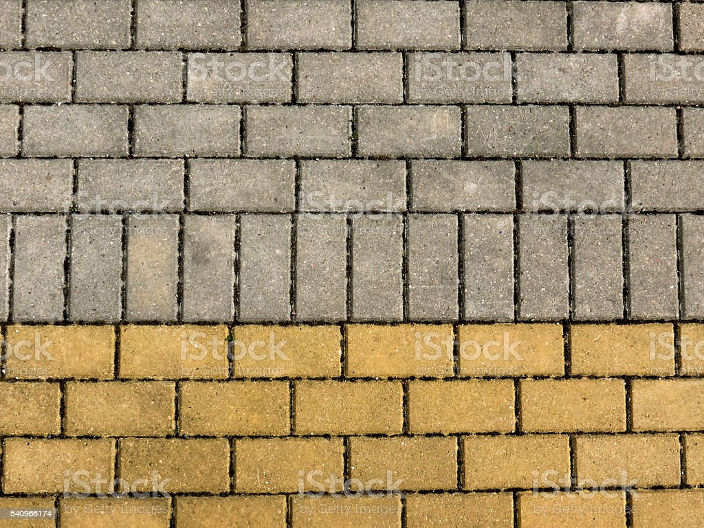 Sidewalk from brick tiles. Yellow, grey color. Horizontal view stock photo